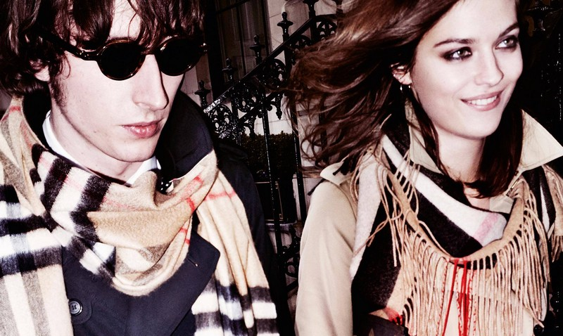 British musician Ranald Macdonald and model Amber Anderson wearing Burberry heritage trench coats and fringed scarves for AW15