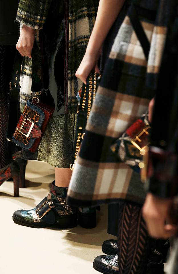 Check coats, The Patchwork and The Buckle Boot line up backstage at the Burberry show