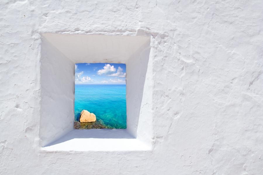 Europe_Spain_Ibiza_Mediterranean white wall window in Formentera beach_attraction_beach_luxury_resort.jpg