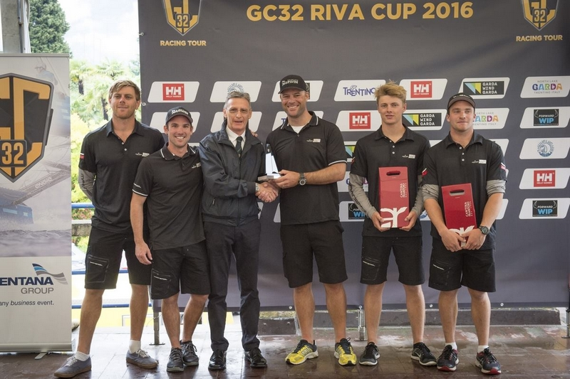 Franck Cammas and his crew on Norauto have won the GC32 Riva Cup after a shifty, rainy final day on Lake