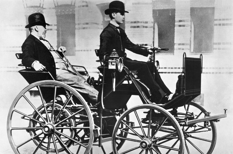 Gottlieb Daimler and his son Adolf on the motor carriage, 1886