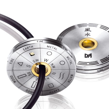 Meister - The coin-size feng shui disc in titanium and gold. Worn as a pendant or as a pocket tool