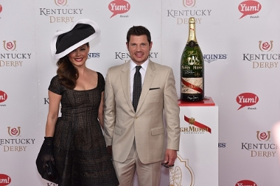 Nick and Vanessa Lachey celebrate with the official champagne of the Kentucky Derby, G.H.MUMM
