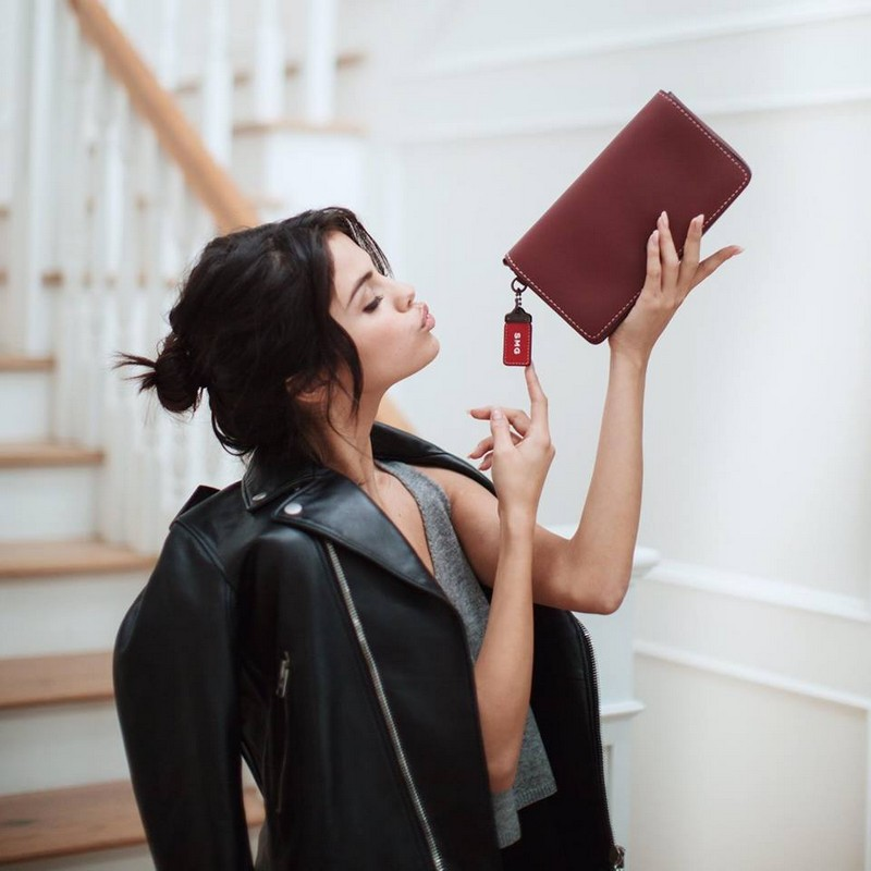 selena-gomez-with-her-monogrammed-glovetanned-leather-dinky-bag