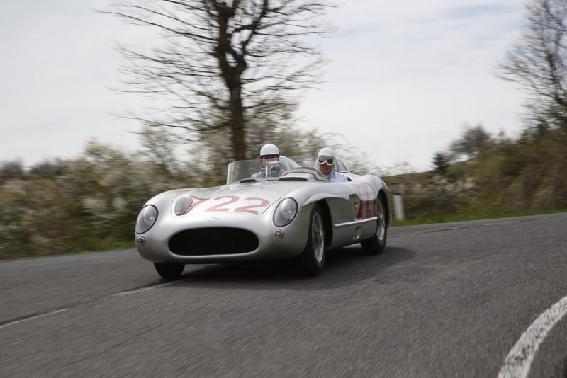 Sir Stirling Moss at the wheel of the 300 SLR with starting number 722 at the Classic Insight 1955 success stories, 23 April 2015 in Italy.