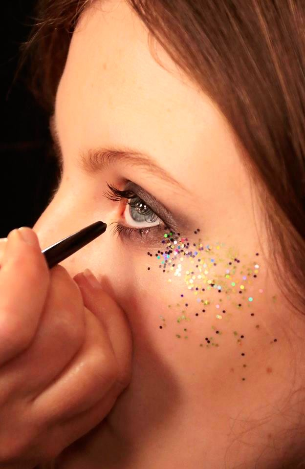 Smoky, glitter-defined eyes created backstage at the Burberry show