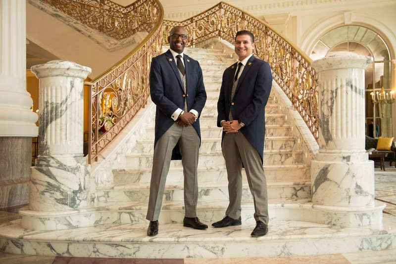 St Regis Dubai hotel - Amado Silveti and Moussa Niang, recognized with the prestigious distinction Les Clefs d'Or, certifying excellence in Concierge services