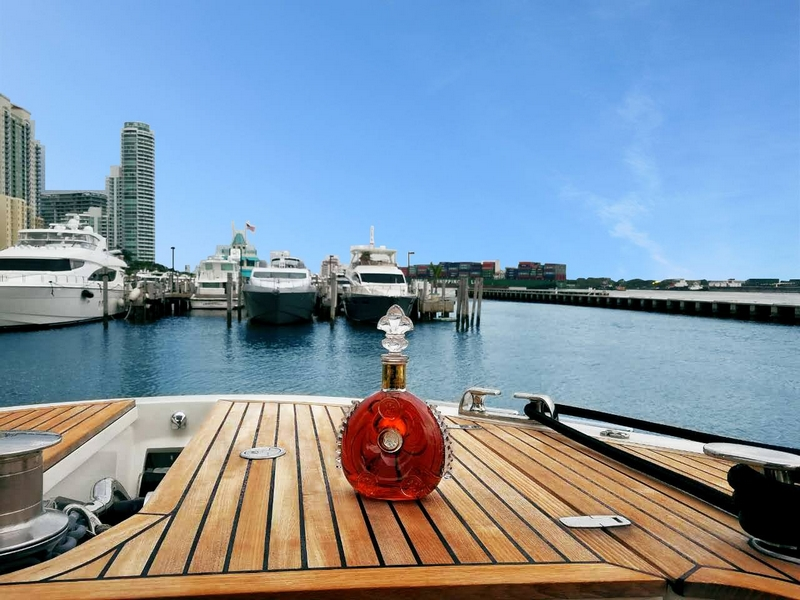 The LOUIS XIII decanter stands out against the deep blue sky of Miami