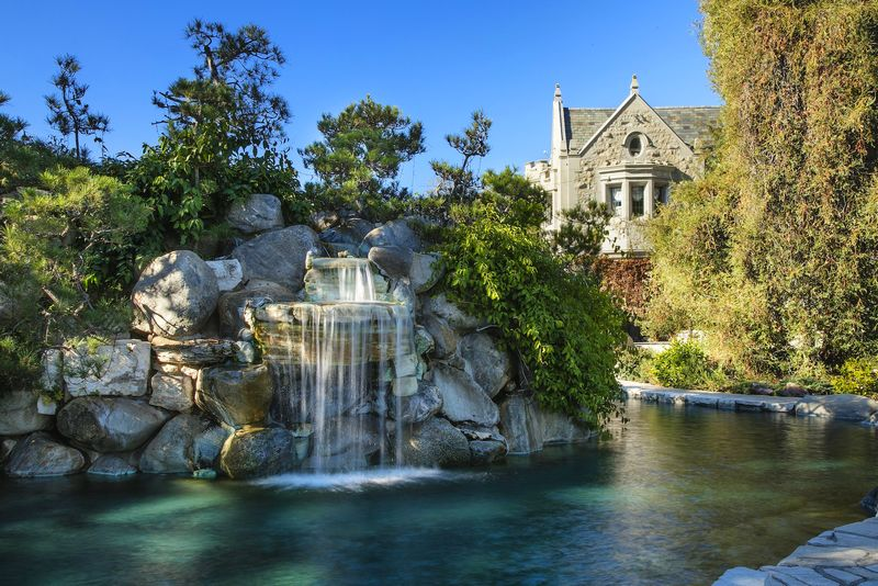 The Playboy Mansion sold-waterfall