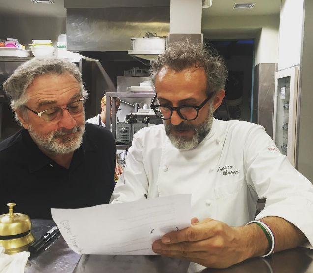 massimo bottura and robert de niro in the kitchen cooking