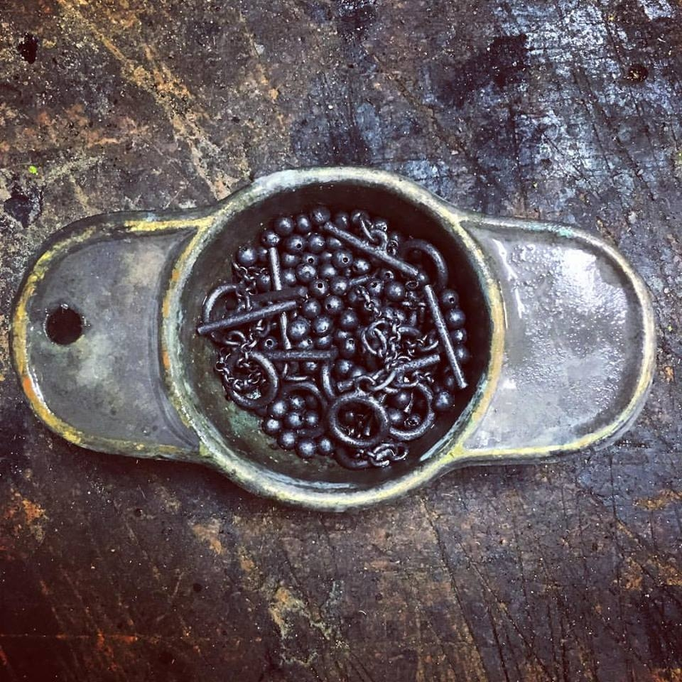 thisishenson jewelry- Black handmade beads before they are off for stringing
