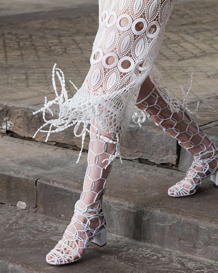 A Closer Look - the fringe and eyelet detailing on a white guipure dress from FerragamoSS 2020