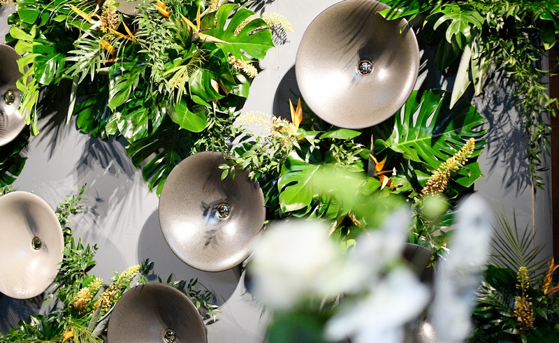 A wall of Shagreen sinks rising from a vertical garden designed by Milan-based landscape architect Derek Castiglioni