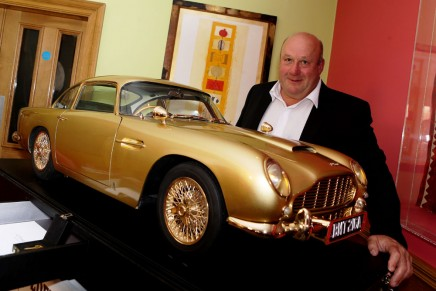Gold replica of James Bond's iconic Aston Martin DB5 sold for £55,000