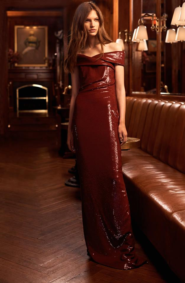 An off-the-shoulder silhouette and sequined silk georgette define an evening gown from Ralph Lauren's Pre-Fall Collection