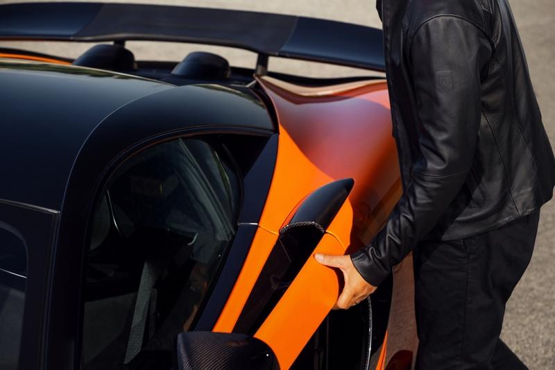 Belstaff X McLaren Collection - Hybrid Leather Jacket - model opens the McLaren 600LT