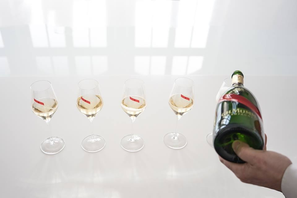 Champagne MUMM-Pouring victory into every glass