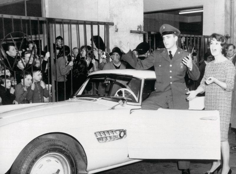 Elvis Presley in front of his BMW 507