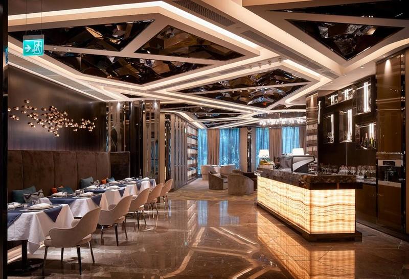 Hirsch Bedner Associates (HBA) completes Ultima Residences - restaurant