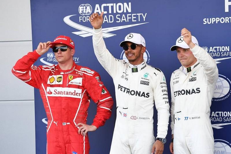 Kimi Raikkonen Ferrari, Pole sitter Lewis Hamilton Mercedes AMG F1 and Valtteri Bottas