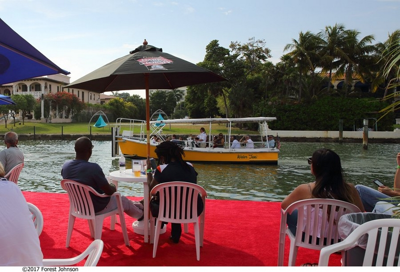 MiamiYachtShow-gallery-enjoy a drink in one of the cocktail barges with food & live music