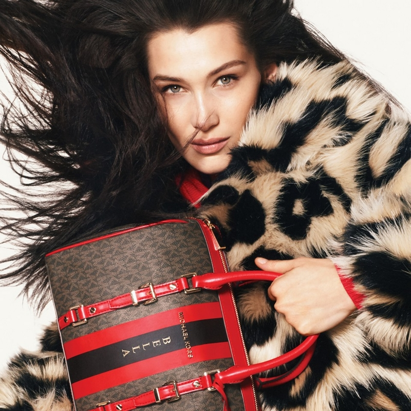 Michael Kors Bella Hadid and her hand-worn bag from Bedford Travel