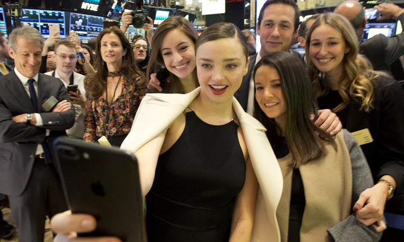 Model Miranda Kerr, centre, partner of Snapchat boss Evan Spiegel, takes a selfie at the launch of Snapchat on the New York Stock Exchange