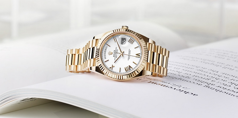 Rolex Day-Date 40 in 18ct yellow gold, with white dial, bevelled deconstructed Roman numerals and President bracelet