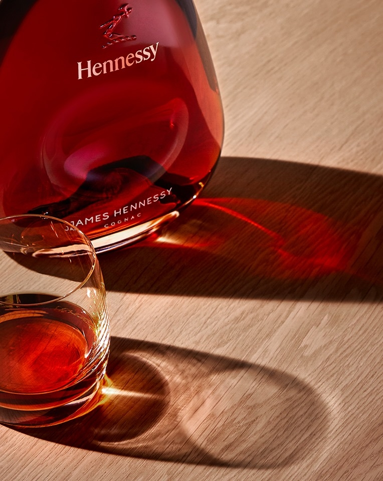 Shimmering amber with reflections of bronze illuminate the modern elegance of James Hennessy