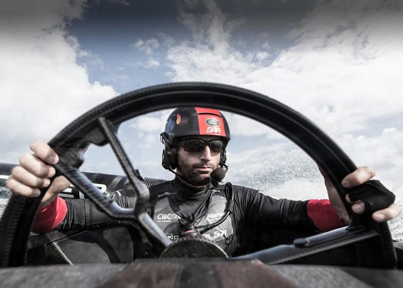 Sir Ben Ainslie with Land Rover steering wheel in Bermuda