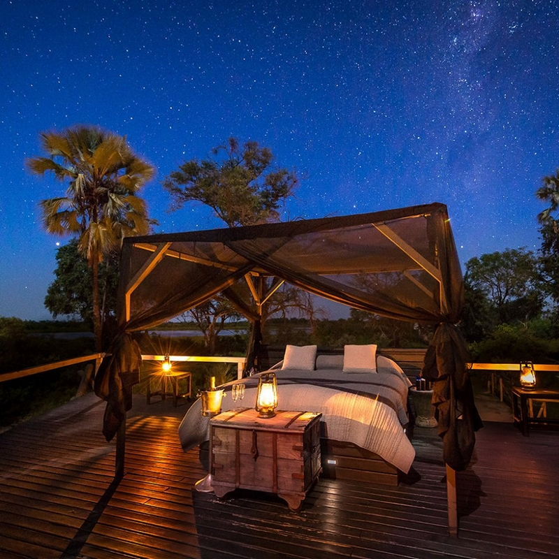 Sleep under the twinkling stars at the luxurious Abu Camp in the Okavango Delta