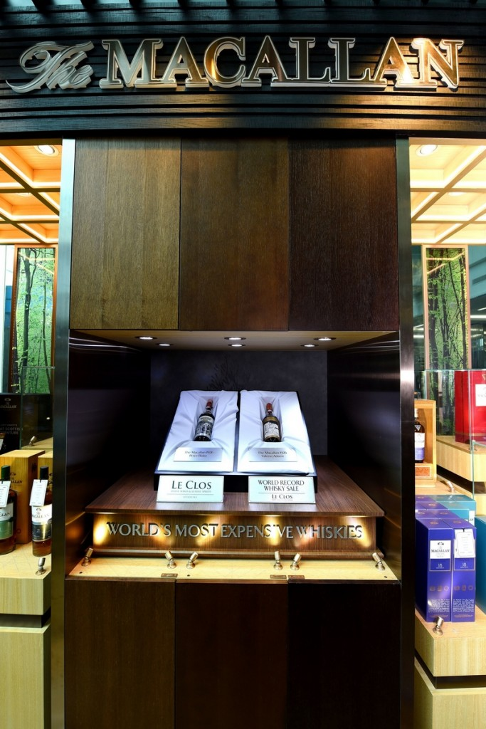 The Macallan 1926 Peter Blake and Valerio Adami bottles on display in Le Clos at Dubai Airport