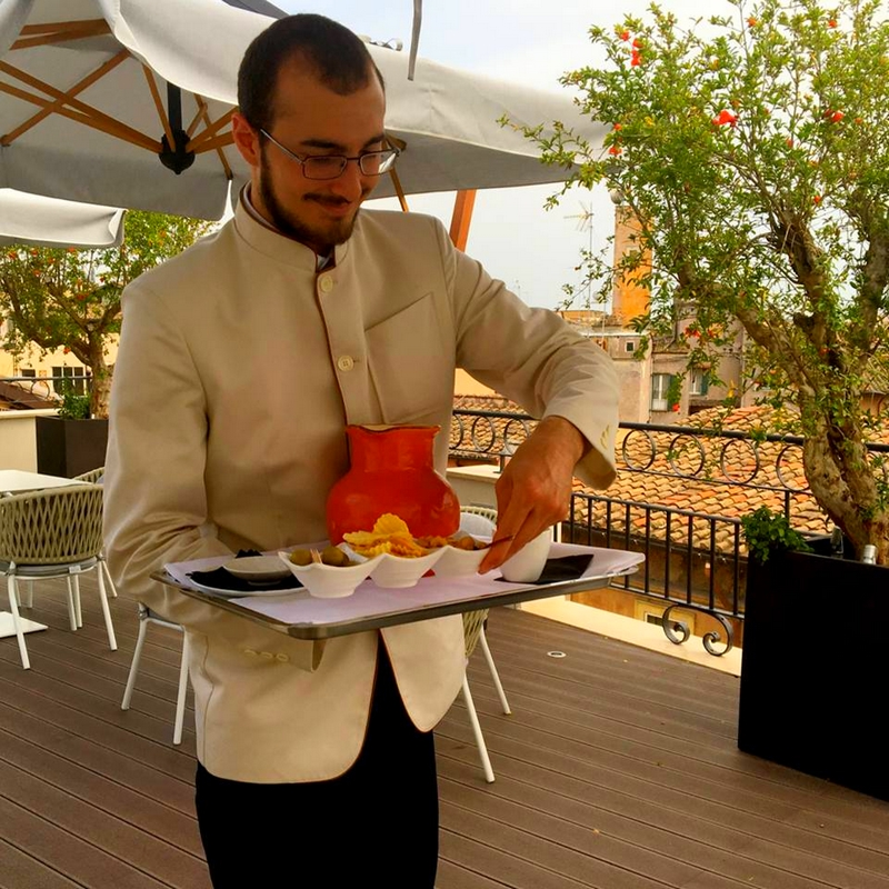 The Pantheon Iconic Rome Hotel - The elegant sixth-floor Divinity Rooftop Terrace is designed for meeting and mingling-