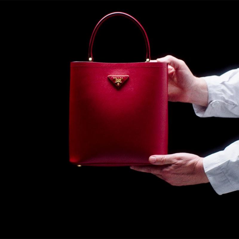 The Prada Panier bag's minimalist design is enhanced by sophisticated details