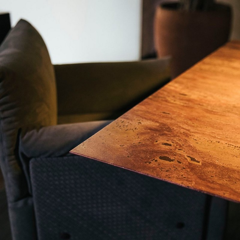 The collection's first-ever rectangular dining table is in red travertine-details