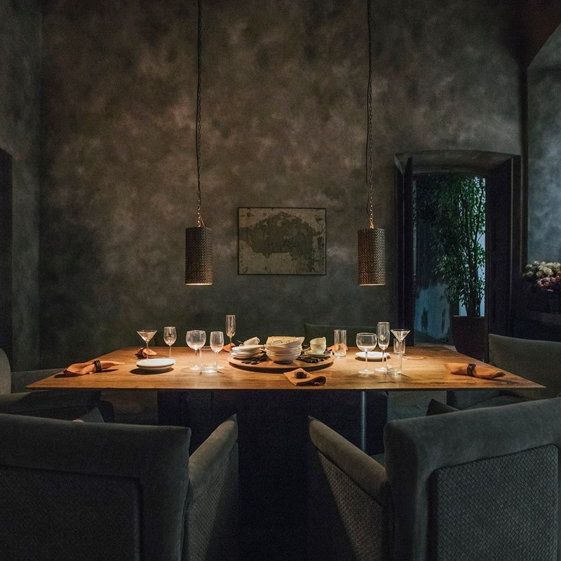 The collection's first-ever rectangular dining table is in red travertine