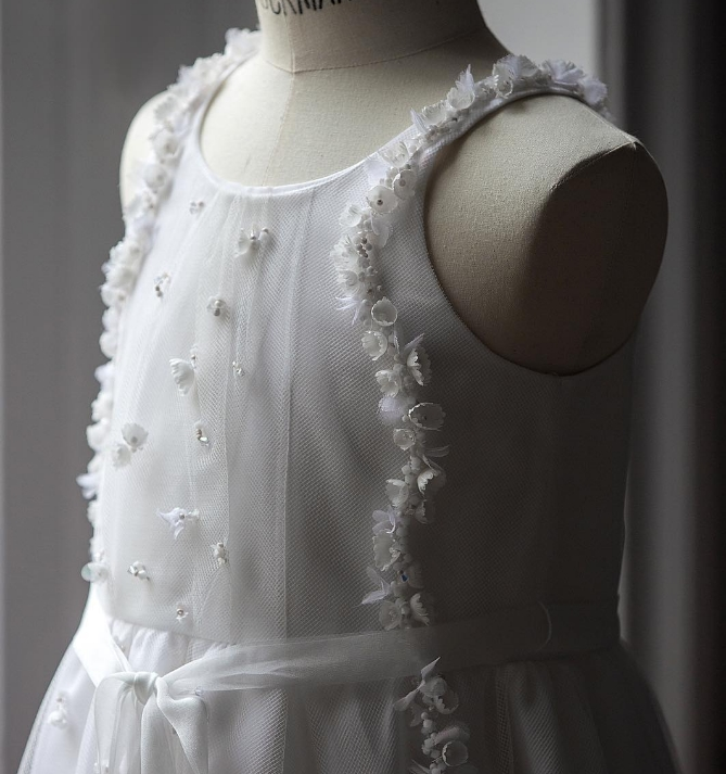 The finished white #BabyDior dress designed by CordeliadeCastellane for the little flower girl at MirandaKerr's wedding