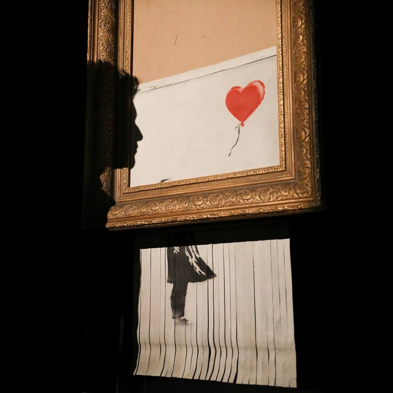 banksy girl with a balloon- the first artwork in history to have been created live during an auction