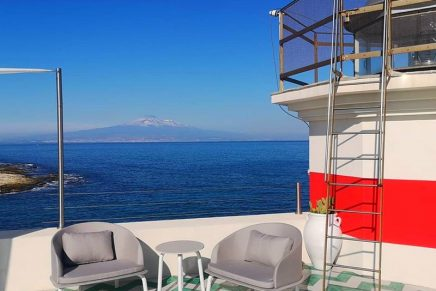 A luxuriously refurbished lighthouse with roof terrace and sublime view of Mount Etna
