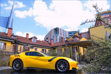 A yellow Ferrari on the hot roof. The prancing horse celebrated during Milan's Design Week