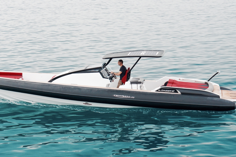 technohull omega 41 RIB on water - red-