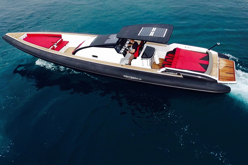 technohull omega 41 RIB on water - red