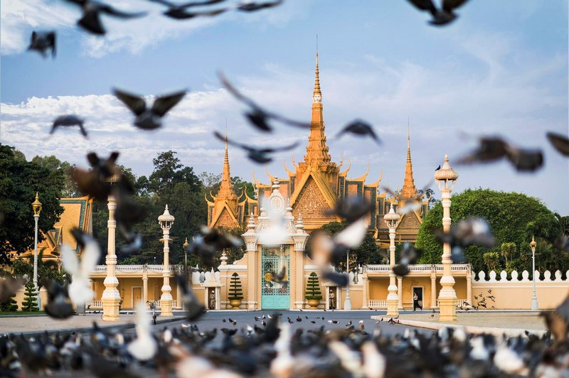the golden Royal Palace — located within walking distance of Rosewood Phnom
