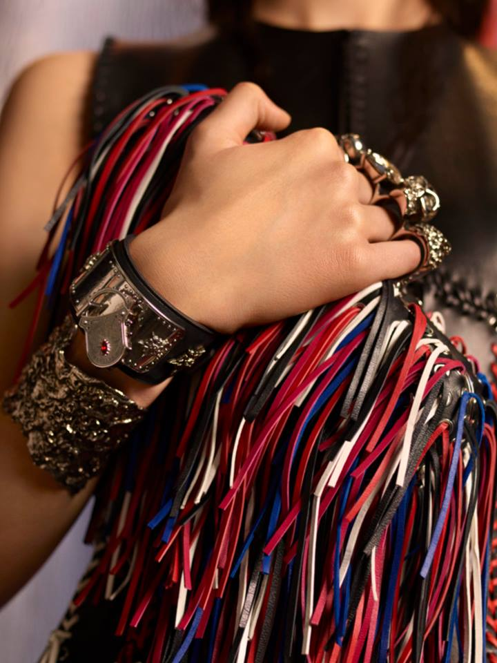 the iconic Four Ring Clutch